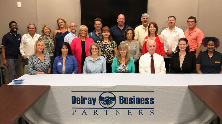 members of the delray business partners lead group sitting at table in delray beach chamber of commerce