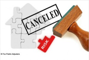 cancelled stamp over puzzle of house
